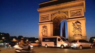 Arc de Triomphe in Paris France lit at night — Stock Video