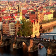 Public transport on a bridge crossing the river in Prague - Stock Photo