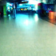 Inside airport terminal - unfocussed - Stock Photo