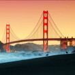 San Francisco's Golden Gate Bridge & ocean waves crashing to shore — Stock Video #19465665