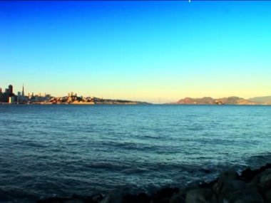 Distant pan shot of San Francisco & Golden Gate Bridge from the bay — Stock Video