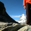 Lone female hiker at the base of the Matterhorn  Switzerland - Photo