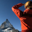 Female hiker enjoying view of the Matterhorn,  Switzerland - Stock Photo