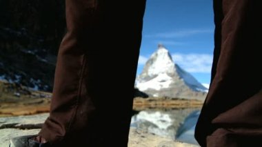 Female hiker enjoying view of the Matterhorn — Stock Video
