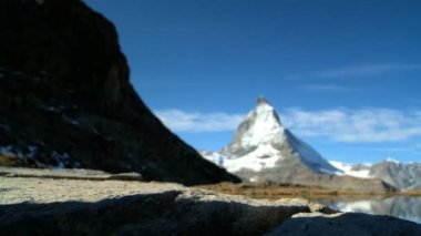 Female hiker stopping to enjoy the view of the Matterhorn — Stock Video