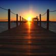 Puesta de sol en el extremo del muelle — Vídeo de stock