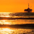 Oil platform at sea at sunset — Vídeo de stock