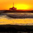Oil platform at sea at sunset — Stock Video