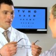 Ophthalmic optician working with patient — Stock Video