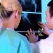 Healthcare staff  working with x-ray charts — Stock Video