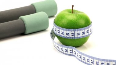 Studio close-up of fresh fruit & exercise aids for healthy living — Stock Video