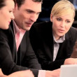 Young successful business colleagues working in advertising - Stock Photo