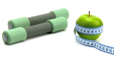 Studio close-up of fresh fruit & exercise aid for healthy living — 图库视频影像