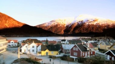 Time-lapse sunset over a Norwegian town beside a fjord — Stock Video