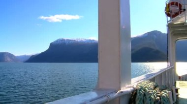 Aboard a large boat on the crystal waters of a glacial fjord — Stock Video