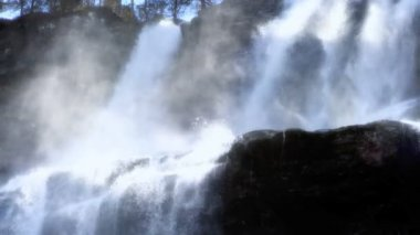 Spray from cascading waters of a powerful waterfall — Stock Video #19856701