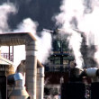 Oil refinery smoke polluting the air in a glacial valley — Stock Video