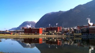 Oil refinery processing North Sea oil beside a glacial fjord — Stock Video #20002377