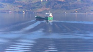 Oil tanker transporting North Sea oil along a glacial fjord — Stock Video