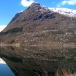 Stock Video: Mirror image of mountains in crystal clear water of nordic fjord