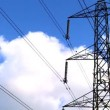 Time-lapse clouds & blue sky behind an electricity pylon — Stock Video #20015661