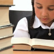 Cute african american schoolgirl early learning with a book — Stock Video #20019307