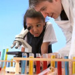 Cute african american schoolgirl with teacher learning elementary science — Stock Video