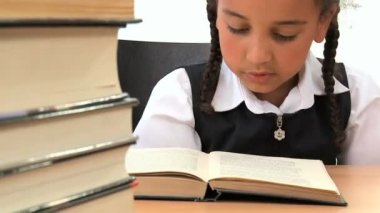 Cute african american schoolgirl early learning with a book — Stock Video