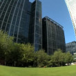 Modern city buildings & workplaces in fish-eye lens - Stock Photo