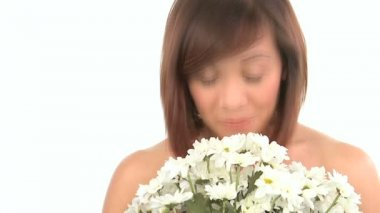 Young western oriental girl enjoying the therapeutic aroma of flowers — Stock Video