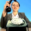 Concept shot of young businesswoman in city clothes using old-fashioned telephone — Stock Video #20201439