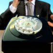 Concept shot of business man in city clothes using old-fashioned telephone in environmental office — Stock Video #20201611