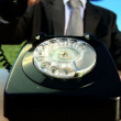 Concept shot of business man in city clothes using old-fashioned telephone in environmental office — Stock Video #20201625