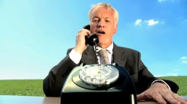 Concept shot of business man in city clothes using old-fashioned telephone in environmental office — Stock Video