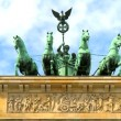 Stock Video: Time-lapse clouds over famous horse & chariot sculptures atop Brandenburg Gate