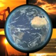 Stock Video: Montage collection of fossil energy production with revolving earth graphic