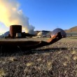 Steam from geothermal energy being piped from natural volcanic hot springs — Stock Video #20277321