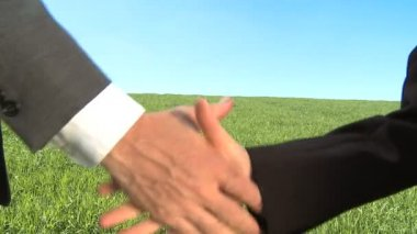 Two business shake hands in concept environmental workplace — Stock Video