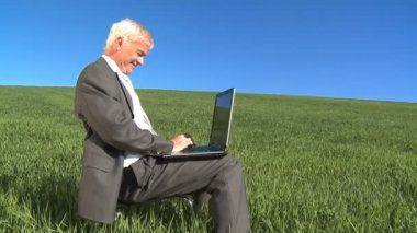 Businessman using laptop in concept environment office daydreaming of a greener future — Stock Video