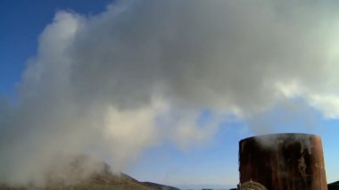 Steam from geothermal energy being piped from natural volcanic hot springs — Stock Video