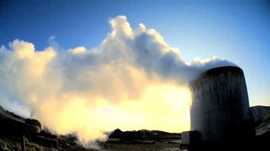 Steam from geothermal energy being piped from natural volcanic hot springs — Stock Video #20277257