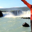 Lone female hiker succeeds in her hike to a landmark waterfall - 