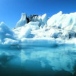 Glacial iceberg slowly melting into the lake through global warming — Stock Video