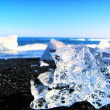 Melting glacial ice from climate change washed up on an arctic beach  — ストックビデオ