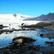 Melting water from Vatnajokull Glacier flowing into a glacial lake — Stock Video