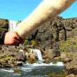 Athletic young couple hiking alone across rough terrain to Pingvellir waterfall — Stock Video