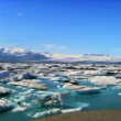 Glacial icebergs slowly melting into a lake through global warming — Stock Video