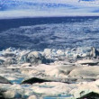 Stock Video: Glacial icebergs slowly melting into a lake through global warming