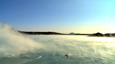 Steam coming from hot volcanic springs bubbling to the surface — Stock Video
