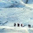 Stock Video: Team of preparing to climb largest glacier in Europe